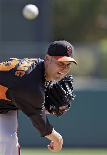 San Francisco Giants starting pitcher Ryan Vogelsong delivers against the Chicago White Sox in the second inning of an exhibition spring training baseball game Monday, March 4, 2013, in Glendale, Ariz. (AP Photo/Mark Duncan)