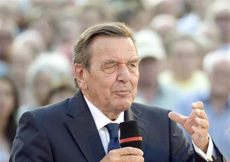 Former German Chancellor Schroeder delivers his speech as he supports Social Democratic top candidate Steinbrueck (SPD) (not pictured) during an election campaign in Hanover