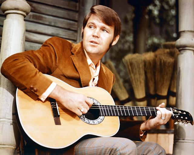 "<p>The ""Rhinestone Cowboy"" singer died Aug. 8, following a long battle with Alzheimer's disease. The <a href=""https://www.yahoo.com/music/glen-campbell-1936-2017-204219238.html"" data-ylk=""slk:country music legend;outcm:mb_qualified_link;_E:mb_qualified_link"" class=""link rapid-noclick-resp newsroom-embed-article"">country music legend</a> had 21 top 40 hits throughout his versatile career. Campbell announced his diagnosis in June 2011 and said his disease was in an early stage at that time. He was 81. (Photo: Getty Images) </p>"