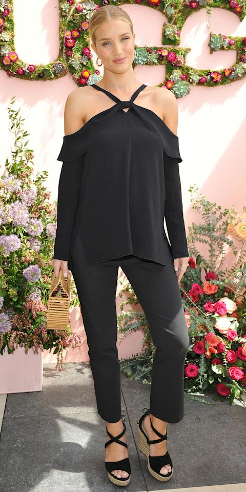 <p>The expectant star wowed at an UGG luncheon in Los Angeles, where she opted to dress her growing baby bump in all black. For the occasion, Huntington-Whitley wore a shoulder-baring top, cropped trousers, and coordinating wedges. A bamboo handbag and hoop earrings finished off her outfit.</p>