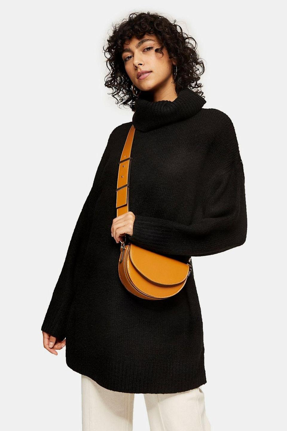 """<br><br><strong>Topshop</strong> Oversized Roll Neck Knitted Sweater Dress, $, available at <a href=""""https://go.skimresources.com/?id=30283X879131&url=https%3A%2F%2Fus.topshop.com%2Fen%2Ftsus%2Fproduct%2Fclothing-70483%2Fdresses-70497%2Fdtos-roll-dress-blk-9431077"""" rel=""""nofollow noopener"""" target=""""_blank"""" data-ylk=""""slk:Topshop"""" class=""""link rapid-noclick-resp"""">Topshop</a>"""