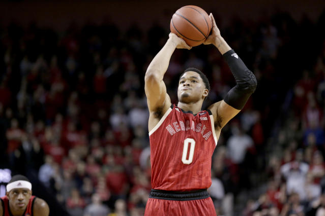 James Palmer Jr. (0) shoots the go-ahead and eventual game-winning free throw as teammate Glynn Watson Jr., left, watches late in the second half of an NCAA college basketball game against Minnesota in Lincoln, Neb., Wednesday, Feb. 13, 2019. Nebraska won 62-61. (AP Photo/Nati Harnik)
