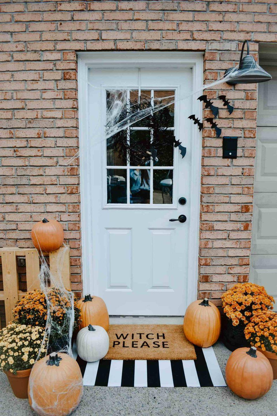 """<p>Sometimes the best way to display your pumpkins is with other head-turning Halloween décor. After all, how cute is this """"Witch Please"""" set up?</p><p><strong>See more at <a href=""""https://www.houseonlongwoodlane.com/home-renovation/diy-halloween-door-mat-front-porch/"""" rel=""""nofollow noopener"""" target=""""_blank"""" data-ylk=""""slk:The House On Longwood Lane"""" class=""""link rapid-noclick-resp"""">The House On Longwood Lane</a>. </strong></p><p><a class=""""link rapid-noclick-resp"""" href=""""https://www.amazon.com/NANTA-Striped-Washable-Outdoor-Farmhouse/dp/B07XJZH6WX?tag=syn-yahoo-20&ascsubtag=%5Bartid%7C2164.g.36877187%5Bsrc%7Cyahoo-us"""" rel=""""nofollow noopener"""" target=""""_blank"""" data-ylk=""""slk:SHOP BLACK AND WHITE DOORMATS"""">SHOP BLACK AND WHITE DOORMATS</a></p>"""
