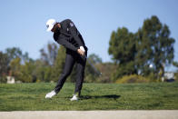 Dustin Johnson hits his second shot on the first hole during the third round of the Genesis Invitational golf tournament at Riviera Country Club, Saturday, Feb. 20, 2021, in the Pacific Palisades area of Los Angeles. (AP Photo/Ryan Kang)