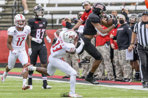 Louisiana-Lafayette wide receiver Kyren Lacy (2) makes a catch against South Alabama safety Keith Gallmon (33) in the first half of an NCAA college football game in Lafayette, La., Saturday, Nov. 14, 2020. (AP Photo/Matthew Hinton)