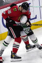 Chicago Blackhawks defenseman Nikita Zadorov, left, works for the puck against Dallas Stars center Radek Faksa during the second period of an NHL hockey game in Chicago, Sunday, May 9, 2021. (AP Photo/Nam Y. Huh)