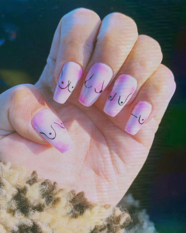 "<p>When we said ""free the nipple,"" Demi really felt that. The pop star got tiny titties painted on her coffin nails, to celebrate the human form. She added the inclusive design atop a tie-dye base, for a truly adorable look. </p><p><a href=""https://www.instagram.com/p/CJ7GzwlB_Wr/"" rel=""nofollow noopener"" target=""_blank"" data-ylk=""slk:See the original post on Instagram"" class=""link rapid-noclick-resp"">See the original post on Instagram</a></p>"