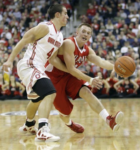 Miami (Ohio)'s Brian Sullivan, right, drives to the basket against Ohio State's Aaron Craft during the first half of an NCAA college basketball game Thursday, Dec. 22, 2011, in Columbus, Ohio. (AP Photo/Jay LaPrete)