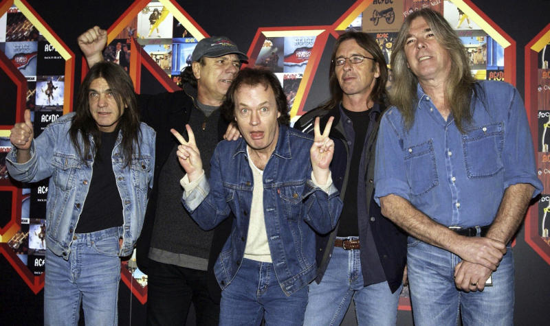 FILE - A March 3, 2003 file photo of from left: Malcolm Young, Brian Johnson, Angus Young, Phil Rudd and Cliff Williams from AC/DC posing for photographers at the Apollo Hammersmith in London. The band has announced, Saturday Nov. 18, 2017, that 64-year-old Young has died. (Yui Mok/PA via AP)