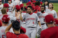 Cincinnati Reds players come off the field after game two of a baseball doubleheader against the Kansas City Royals Wednesday, Aug. 19, 2020, in Kansas City, Mo. (AP Photo/Charlie Riedel)