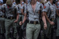 Members of La Legion, an elite unit of the Spanish Army, react before the start of a military parade celebrating a holiday known as 'Dia de la Hispanidad' or Hispanic Day in Madrid, Spain, Tuesday, Oct. 12, 2021. Spain commemorates Christopher Columbus' arrival in the New World and also Spain's armed forces day. (AP Photo/Manu Fernandez)