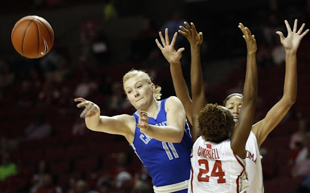 Creighton's McKenzie Fujan (11) passes a ball away from Oklahoma's Sharane Cambell (24) and Nicole Griffin during the first half of an NCAA college basketball game in Norman, Okla., Sunday, Dec. 1, 2013. (AP Photo/Garett Ray Fisbeck)