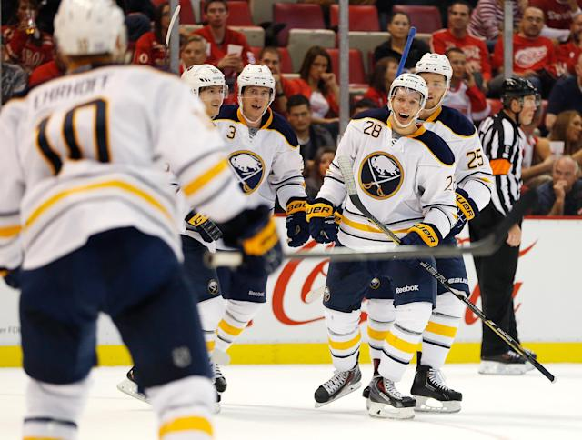 DETROIT, MI - OCTOBER 02: Zemgus Girgensons #28 of the Buffalo Sabres celebrates his third-period goal with teammates including Christian Ehrhoff #10 while playing the Detroit Red Wings at Joe Louis Arena on October 2, 2013 in Detroit, Michigan. (Photo by Gregory Shamus/Getty Images)