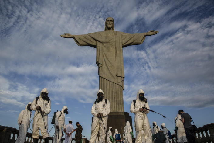 Military personnel disinfect the Christ the Redeemer monument in Rio de Janeiro on August 13, 2020 (Dado Galdieri / The New York Times).