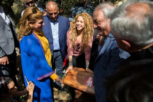 A handout picture from the Honorary Consulate of Lebanon in Barranquilla, Colombia, on July 13, 2018 shows Colombian singer Shakira (C) holding a commemorative plaque bearing her name during her visit to the northern Lebanese village of Tannourine