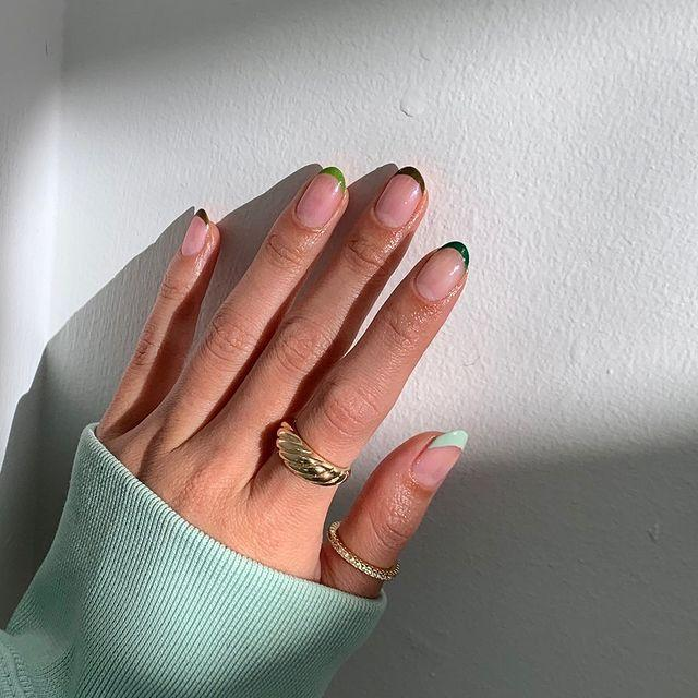 "<p>This 2021 version of the <a href=""https://www.cosmopolitan.com/style-beauty/beauty/g29760575/french-manicure-ideas/"" rel=""nofollow noopener"" target=""_blank"" data-ylk=""slk:French manicure"" class=""link rapid-noclick-resp"">French manicure</a> is by far my favorite take on the classic look. Prep your nails with a <a href=""https://www.amazon.com/OPI-Nail-Lacquer-Base-Natural/dp/B004220C6E?tag=syn-yahoo-20&ascsubtag=%5Bartid%7C10049.g.34702993%5Bsrc%7Cyahoo-us"" rel=""nofollow noopener"" target=""_blank"" data-ylk=""slk:clear base coat"" class=""link rapid-noclick-resp"">clear base coat</a> first, then use five different shades of <a href=""https://www.amazon.com/OPI-Lacquer-Suzi-First-Nails/dp/B00I6EVA2O/ref=sr_1_1_sspa?tag=syn-yahoo-20&ascsubtag=%5Bartid%7C10049.g.34702993%5Bsrc%7Cyahoo-us"" rel=""nofollow noopener"" target=""_blank"" data-ylk=""slk:green nail polish"" class=""link rapid-noclick-resp"">green nail polish</a> (ranging from mint to forest-green) and paint each nail tip in a different color.</p><p><a href=""https://www.instagram.com/p/CHdbX8whGGP/?utm_source=ig_embed&utm_campaign=loading"" rel=""nofollow noopener"" target=""_blank"" data-ylk=""slk:See the original post on Instagram"" class=""link rapid-noclick-resp"">See the original post on Instagram</a></p>"