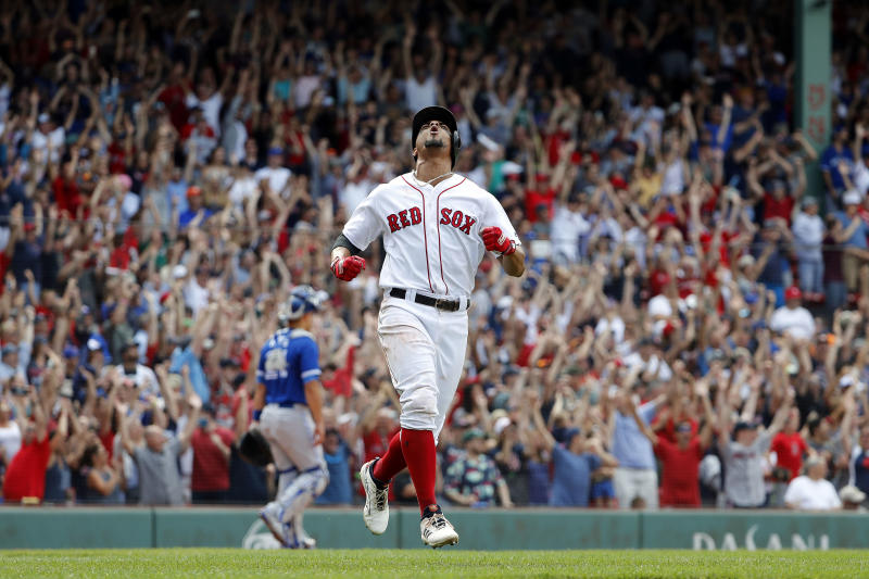 Red Sox shortstop Xander Bogaerts celebrates his walk-off grand slam against the Blue Jays. (AP)