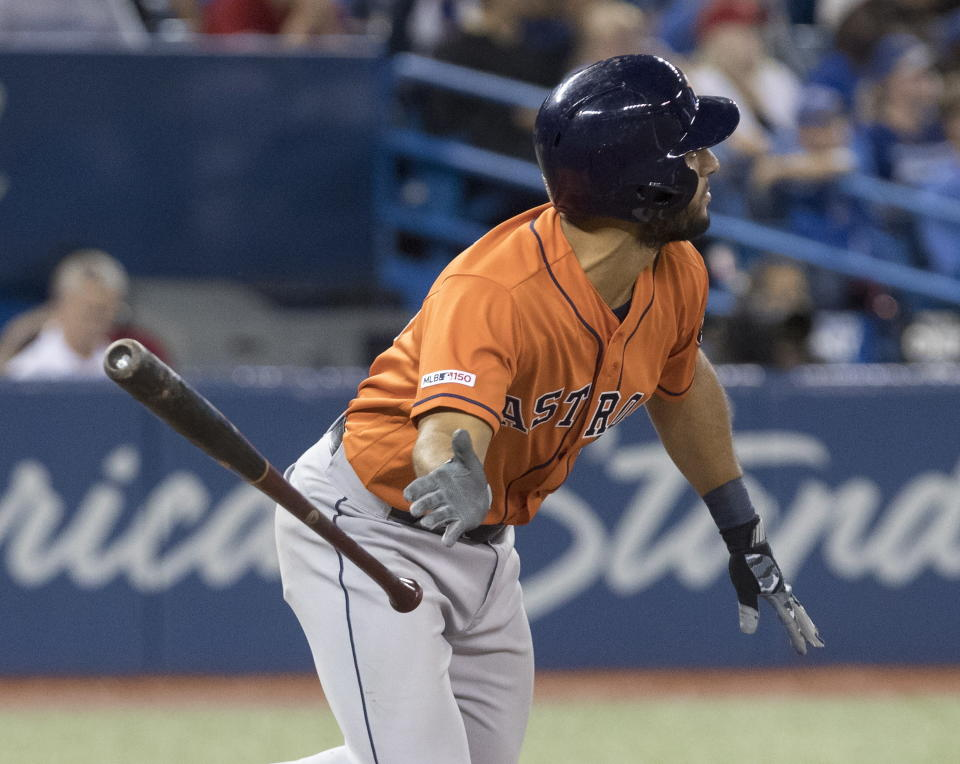 Houston Astros' Abraham Toro watches his two-run home run against the Toronto Blue Jays in the ninth inning of a baseball game in Toronto, Sunday, Sept. 1, 2019. (Fred Thornhill/The Canadian Press via AP)
