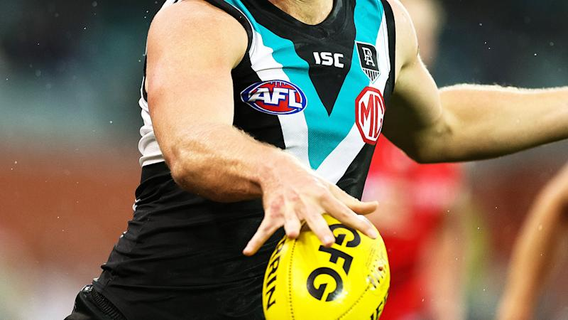 A Port Adelaide player, pictured here in action on the AFL field.