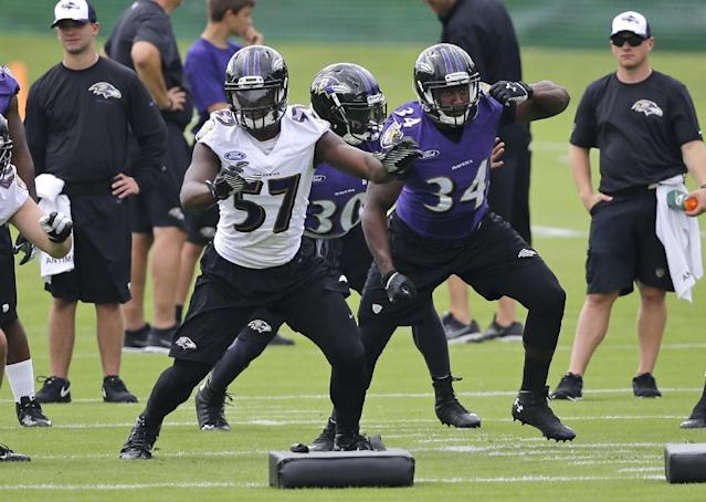 Baltimore Ravens linebacker C.J. Mosley (57) runs a drill alongside running backs Lorenzo Taliaferro (34) and Bernard Pierce at NFL football practice, Tuesday, July 22, 2014, at the team's practice facility in Owings Mills, Md. (AP Photo)