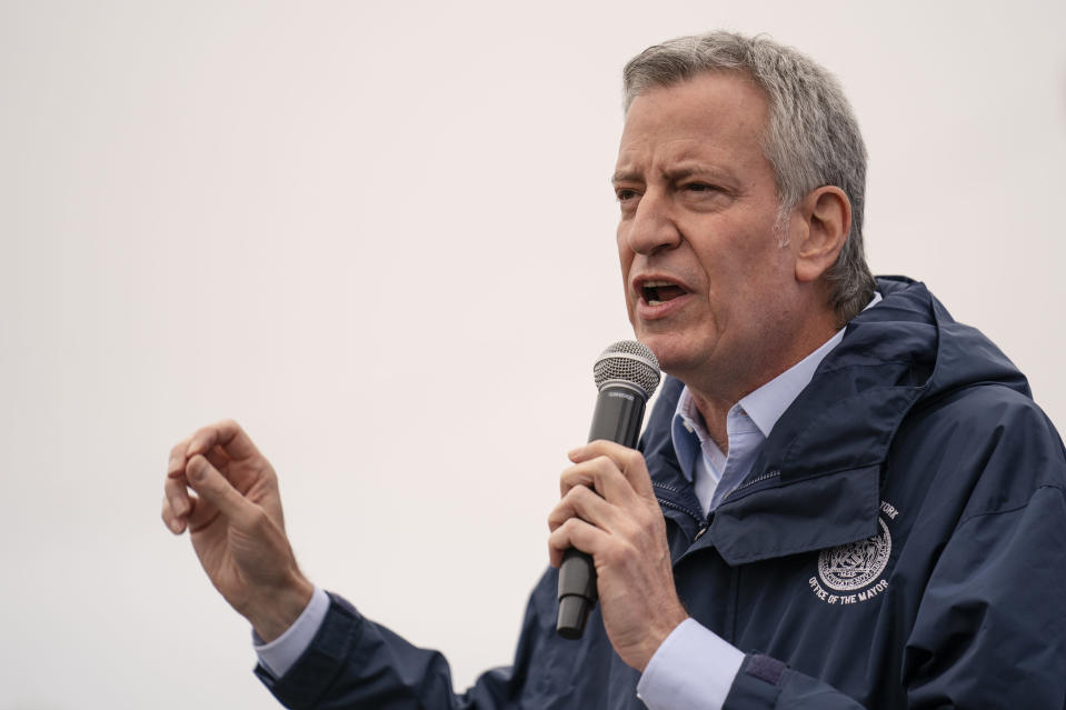 New York City Mayor Bill de Blasio speaks before the ribbon cutting and seasonal opening of the Coney Island amusement park area, Friday, April 9, 2021, in the Brooklyn borough of New York. Coney Island's illustrious amusement parks are reopening Friday after the coronavirus pandemic shuttered them all last year. (AP Photo/John Minchillo)