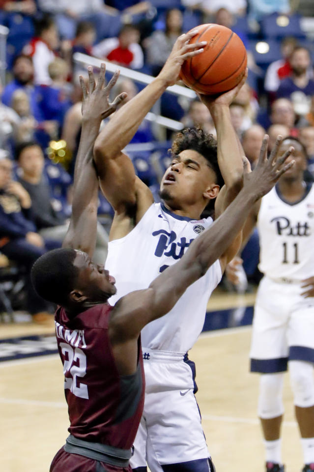 Pittsburgh's Malik Ellison, right, shoots over Maryland Eastern Shore's Gabriel Gyamfi during the first half of an NCAA college basketball game, Saturday, Dec. 15, 2018, in Pittsburgh. (AP Photo/Keith Srakocic)