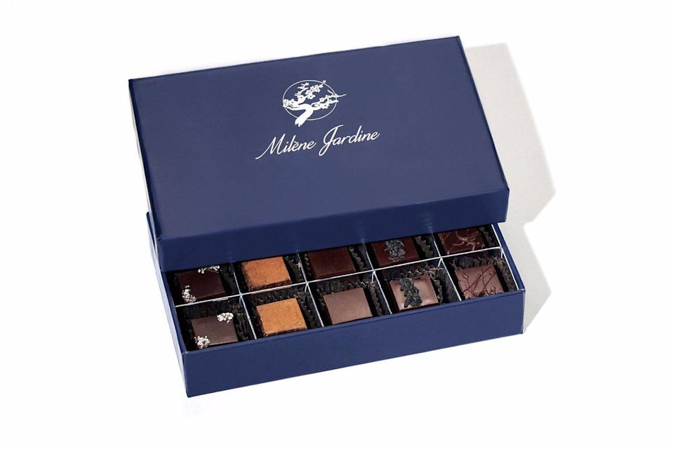 """<p>milenejardine.com</p><p><strong>$45.00</strong></p><p><a href=""""https://milenejardine.com/products/chocolate-truffle-gift-box-15pc"""" rel=""""nofollow noopener"""" target=""""_blank"""" data-ylk=""""slk:Shop Now"""" class=""""link rapid-noclick-resp"""">Shop Now</a></p><p>You may not be able to gift a trip around the world, but you can give the flavors of one all in this box. Think: hibiscus-mint for Egypt, ginger, turmeric, and black pepper inspired by Japan and India, and Irish-influenced whiskey and sea salt. </p>"""