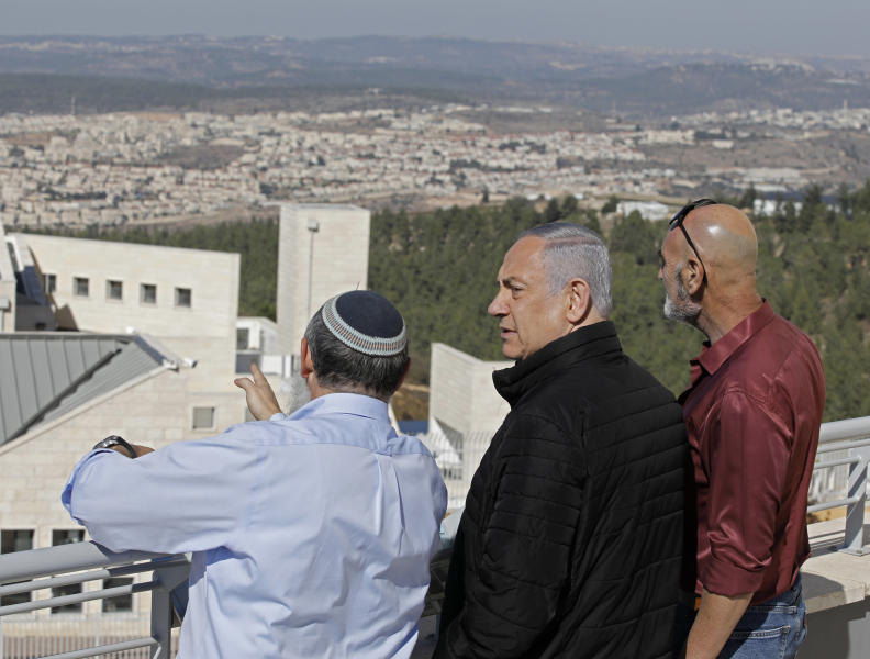 Israeli Prime Minister Benjamin Netanyahu, center, meets with heads of Israeli settlement authorities at the Alon Shvut settlement, in the Gush Etzion block, in the occupied the West Bank, Tuesday, Nov. 19, 2019. (Menahem Kahana/ Pool via AP)
