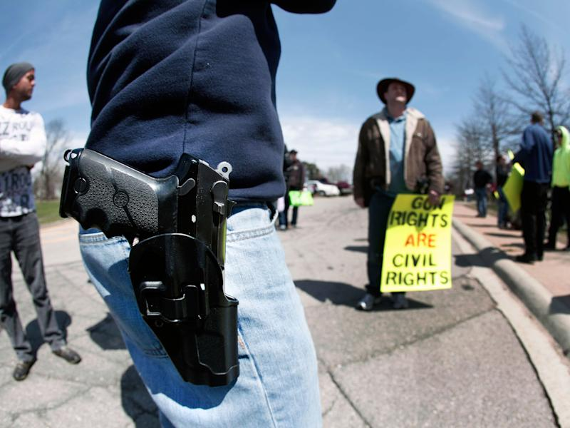 A supporter of Michigan's Open Carry law attends a rally and march April 27, 2014 in Romulus, Michigan: Photo by Bill Pugliano/Getty Images
