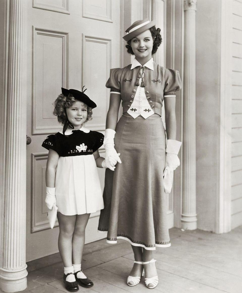 <p>Shirley Temple with co-star Rochelle Hudson in the movie <em>Curly Top</em>.</p>