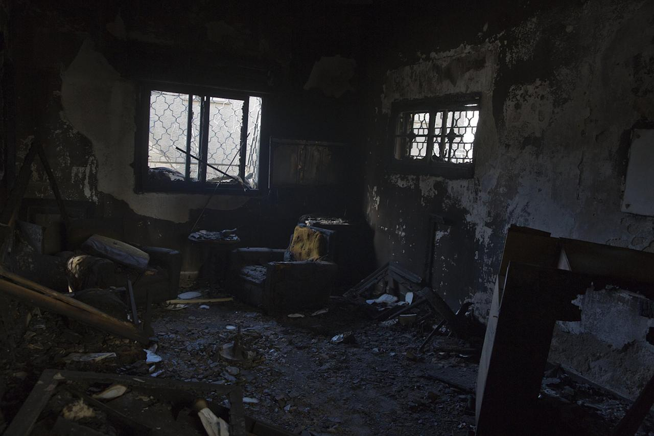 <p>A burned house following wildfires in Haifa, Israel, Nov. 25, 2016. Israeli firefighters reined in a blaze that had spread across the country's third-largest city and forced tens of thousands of people to flee their homes, but continued to battle more than a dozen other fires around the country for the fourth day in a row.(AP Photo/Ariel Schalit) </p>