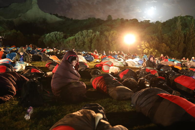 People wait for the Dawn Service ceremony at the Anzac Cove beach, the site of World War I landing of the ANZACs (Australian and New Zealand Army Corps) on April 25, 1915, in Gallipoli peninsula, Turkey, early Thursday, April 25, 2019. As dawn broke, families of soldiers, leaders and visitors gathered near former battlefields, honouring thousands of Australians and New Zealanders who fought in the Gallipoli campaign of World War I on the ill-fated British-led invasion. The doomed Allied offensive to secure a naval route from the Mediterranean to Istanbul through the Dardanelles, and take the Ottomans out of the war, resulted in over 130,000 deaths on both sides.(AP Photo/Emrah Gurel)