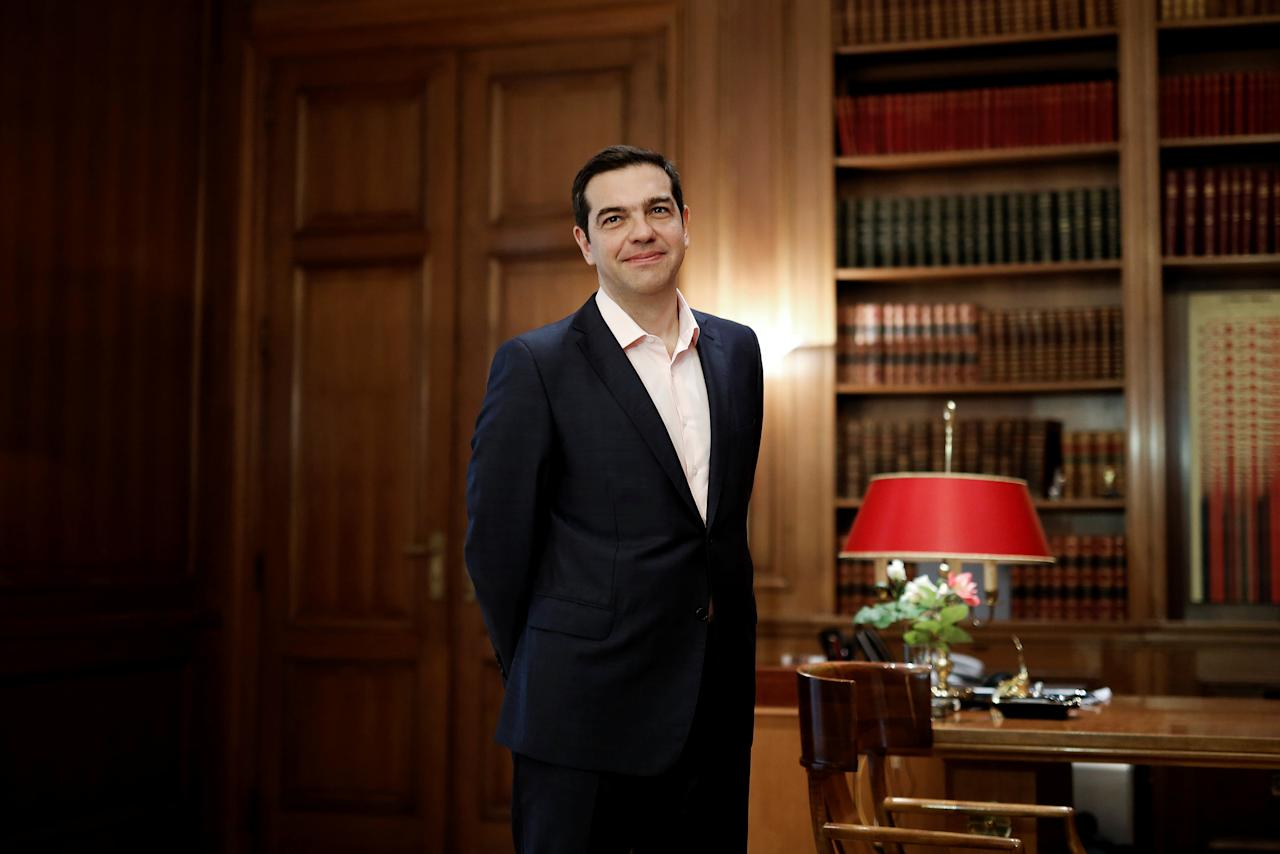 Greek Prime Minister Alexis Tsipras waits to welcome a member of the Politburo of the Communist Party of China, Liu Qibao (not pictured), at his office at the Maximos Mansion in Athens, Greece, April 27, 2017. REUTERS/Alkis Konstantinidis
