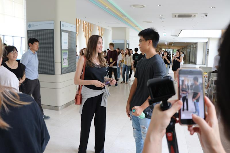 Angelina Jolie speaks to a student at Yonsei University in Seoul, South Korea. She was there to drop off her son Maddox. Photo: Mega