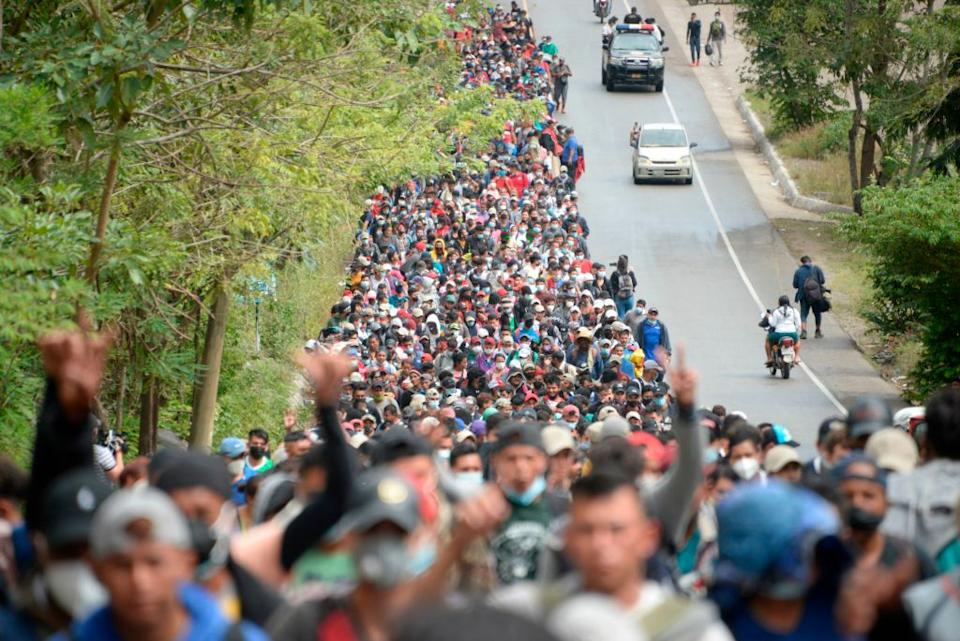 Honduran migrants, part of a caravan heading to the United States, walk along a road in Camotan, Guatemala on January 16. Source: Getty