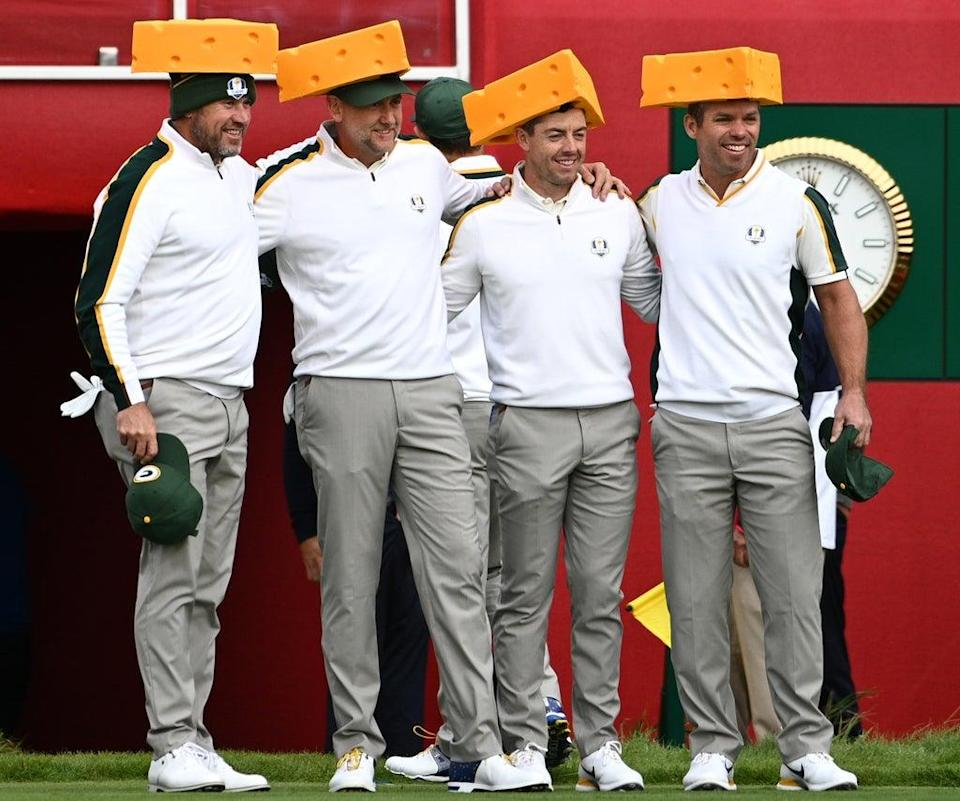 Team Europe's Lee Westwood, Ian Poulter, Rory McIlroy and Paul Casey (left-right) arrive on the first tee wearing Green Bay Packers cheesehead hats ahead of the 43rd Ryder Cup (Anthony Behar/PA) (PA Wire)