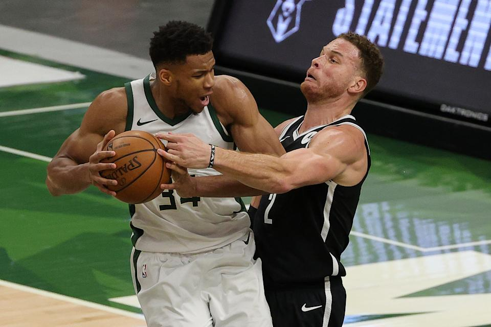 Giannis Antetokounmpo (left) flexed his muscle against the Brooklyn Nets. (Stacy Revere/Getty Images)