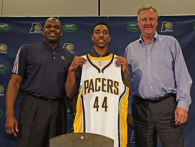Jeff Teague meets the brass. (Getty Images)
