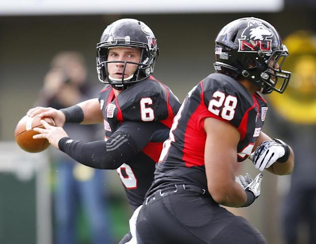 Northern Illinois quarterback Jordan Lynch (6) looks to pass after faking the handoff to running back Joel Bouagnon (28) during the first half of an NCAA college football game against Eastern Michigan on Saturday, Oct. 26, 2013, in DeKalb, Ill. (AP Photo/Jeff Haynes)