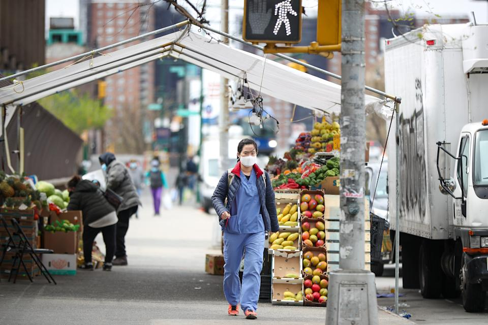 NEW YORK, USA - APRIL 20: A healthcare worker walks with a face mask in front of the Lincoln Hospital in the borough of Bronx, New York City, United States on April 20, 2020 due to Covid-19 pandemic. The state of New York continues to be the coronavirusâ U.S. epicenter. (Photo by Tayfun Coskun/Anadolu Agency via Getty Images)