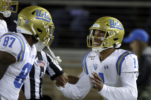 UCLA quarterback Dorian Thompson-Robinson, right, celebrates with Jordan Wilson (87) after scoring a touchdown against Stanford during the first half of an NCAA college football game Thursday, Oct. 17, 2019, in Stanford, Calif. (AP Photo/Ben Margot)