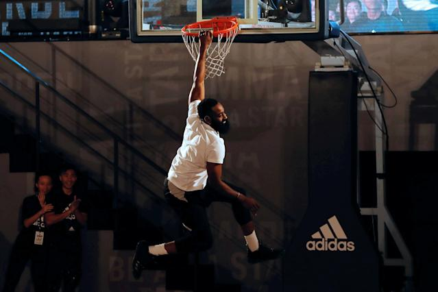 NBA player James Harden of the Houston Rockets slam dunks during a promotional event in Taipei, Taiwan July 5, 2018. REUTERS/Tyrone Siu