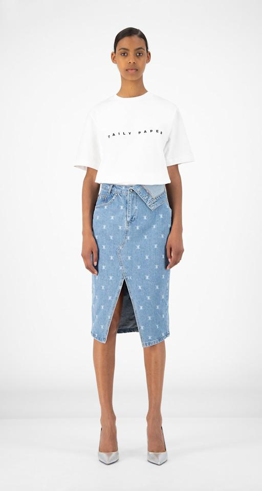 """<p><strong></strong></p><p>dailypaperclothing.com</p><p><strong>$134.00</strong></p><p><a href=""""https://www.dailypaperclothing.com/collections/women-all/products/light-blue-denim-rehowi-skirt?variant=31587380920454"""" target=""""_blank"""">Shop Now</a></p><p>The folded down extended waistband, the knee-length cut and the front slit make this a totally unique option. All you need is a crisp white t-shirt to complete your outfit. </p>"""