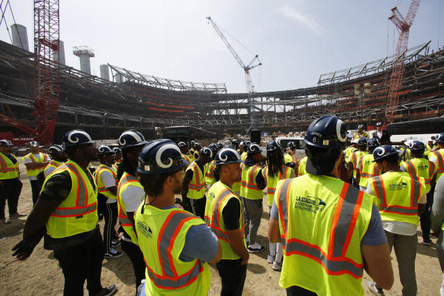 Los Angeles Rams players tour the team's new NFL football stadium Thursday, June 14, 2018, in Inglewood, Calif. Coach Sean McVay scrapped the final practice of minicamp and took his players and coaches on a tour of their multibillion-dollar stadium, which will open for the 2020 season. (AP Photo/Jae C. Hong)