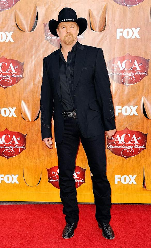 Trace Adkins, who's serving as one of the night's hosts, arrives at the American Country Awards held at the MGM Grand Garden Arena in Las Vegas. (12/05/2011)
