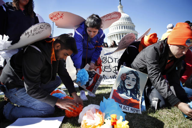 """<p>Supporters of the Deferred Action for Childhood Arrivals (DACA) program place paper flowers on the ground in a pattern that spells out the word """"unafraid"""" as they rally in support of DACA recipients, Monday, March 5, 2018, on Capitol Hill in Washington. (Photo: Jacquelyn Martin/AP) </p>"""
