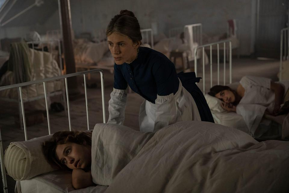 """Lou de Laâge (bottom) stars as a French woman committed to an institution when she claims to communicate with spirits and Melanie Laurent (who also directs) is the nurse who looks out for her in """"The Mad Women's Ball."""""""