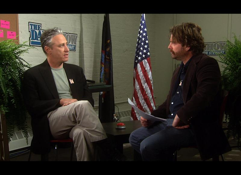 "Backstage at ""The Daily Show,"" Zach Galifianakis gives Jon Stewart <a href=""http://www.funnyordie.com/videos/5325b03b52/between-two-ferns-with-zach-galifianakis-jon-stewart"">the ""Between Two Ferns"" treatment</a>."