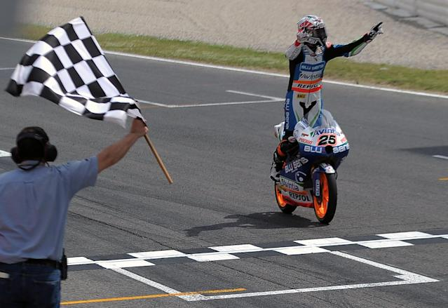 Blusens Avintia's Spanish Maverick Vinales celebrates while crossing the finish line after winning the Moto3 race of the Catalunya Moto GP Grand Prix at the Catalunya racetrack in Montmelo, near Barcelona, on June 3, 2012. Blusens Avintia's Spanish Maverick Vinales won the race ahead of Red Bull KTM Ajo's German Sandro Cortese and Estrella Galicia's Portuguese Miguel Oliveira. AFP PHOTO / LLUIS GENELLUIS GENE/AFP/GettyImages