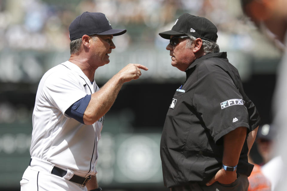 Seattle Mariners manager Scott Servais, left, argues with first base umpire Hunter Wendelstedt before being ejected in the fourth inning of a baseball game against the Houston Astros, Wednesday, July 28, 2021, in Seattle. (AP Photo/Jason Redmond)